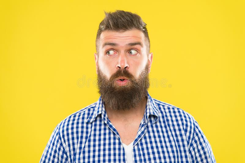 Man bearded hipster wondering face yellow background close up. Guy surprised face expression. Hipster with beard and. Mustache emotional surprised expression stock photo