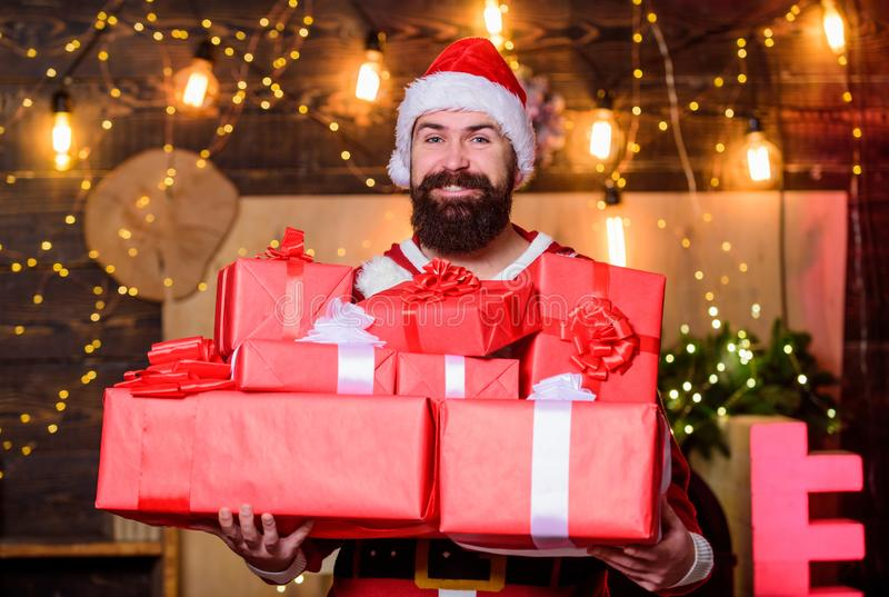 Man bearded santa celebrate christmas with presents. May your home be filled with all joys of season. New year royalty free stock photo
