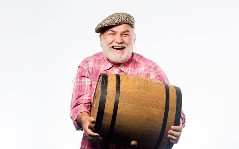 Man bearded senior carry wooden barrel for wine white background. Fermentation product. Natural wine made out of organic stock photo