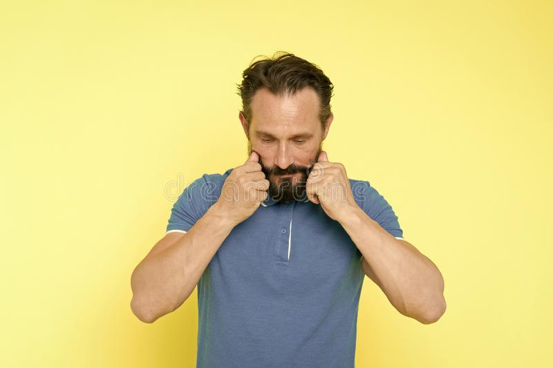 Man bearded twisting moustache yellow background. Ultimate moustache grooming guide. Hipster handsome mature thoughtful. Guy. Expert tips for growing and stock photo