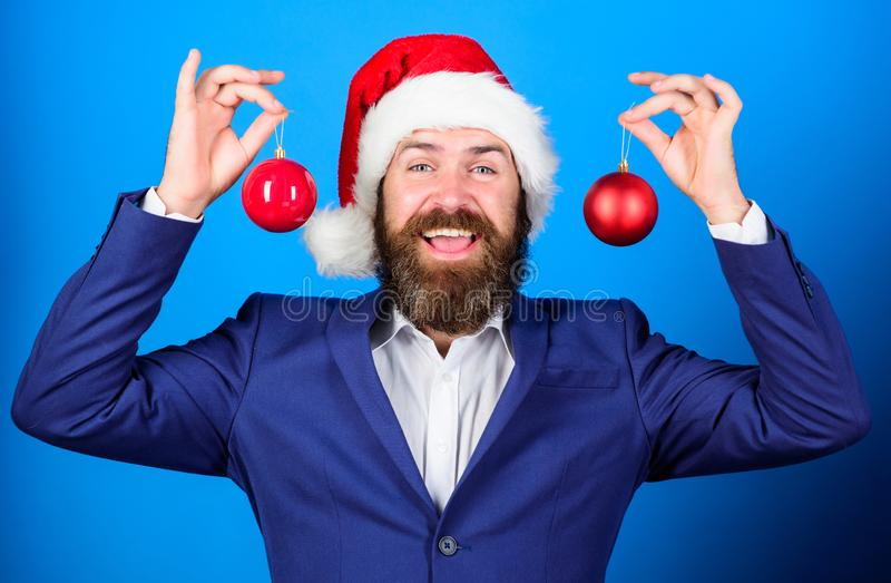 Man bearded wear formal suit and santa hat. Businessman join christmas celebration. Santa hold christmas ball decoration stock images