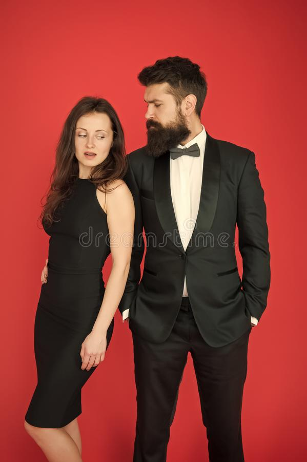 Man bearded wear tuxedo girl elegant dress. Visiting event or ceremony. Couple classy clothes. Elite event. Main rules. Picking clothes. Corporate party. All stock image