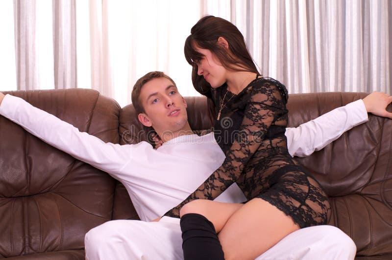 Man and beautiful woman sitting on stock photography