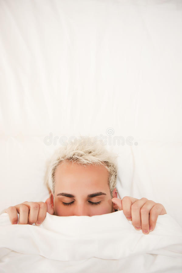 Man in bed royalty free stock images