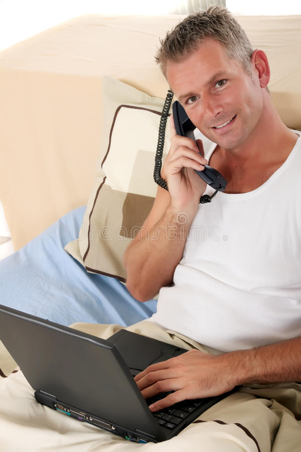 Download Man bedroom laptop stock photo. Image of relaxation, home - 11702740