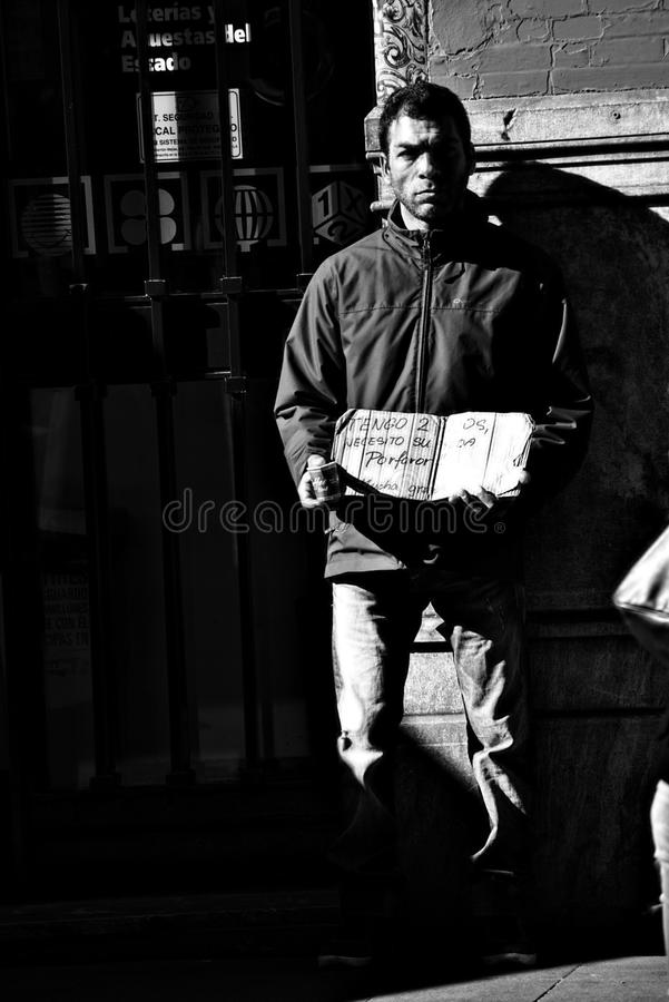 Man begging in the street, 20. This is an urban scen, aman begging in the street stock photos