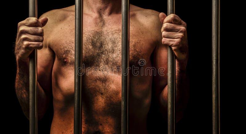 Man behind bars stock photos