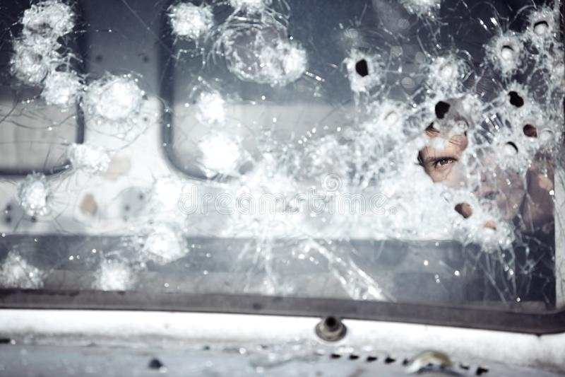 Man behind broken glass stock photography
