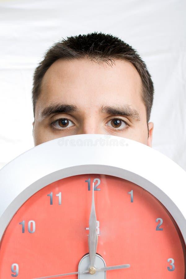 Man Behind Clock Stock Images