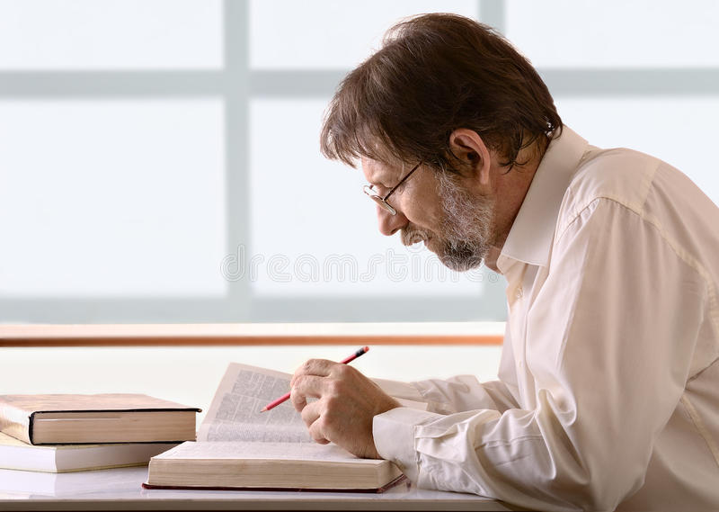 Download Man behind a desk stock photo. Image of education, older - 23760860