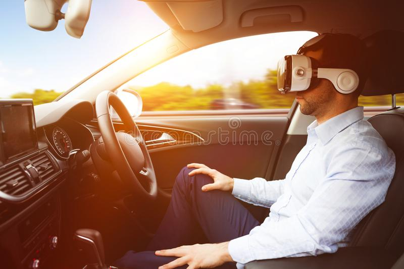 man behind the wheel wearing a virtual reality helmet royalty free stock photo