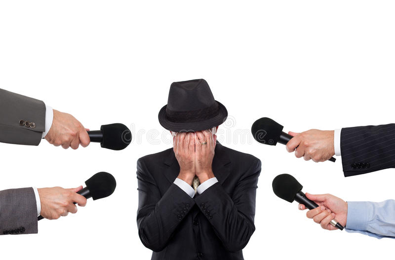Man being interviewed sorounded by reporters royalty free stock photography