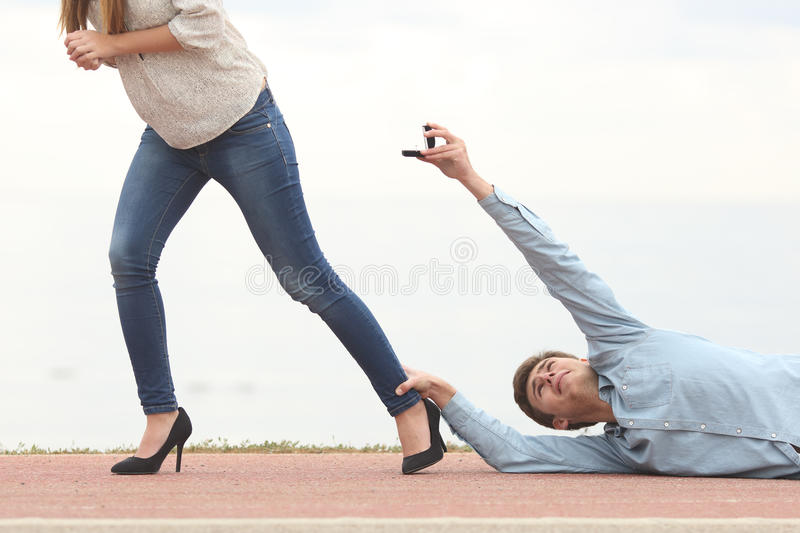 Man being rejected when is proposing marriage. Man being rejected by his girlfriend when is proposing marriage stock photos