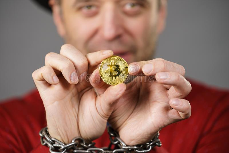 Man being tied up in block chain. Man having problems with crypto currency. Adult guy being tied up with block chain bitcoin royalty free stock photo