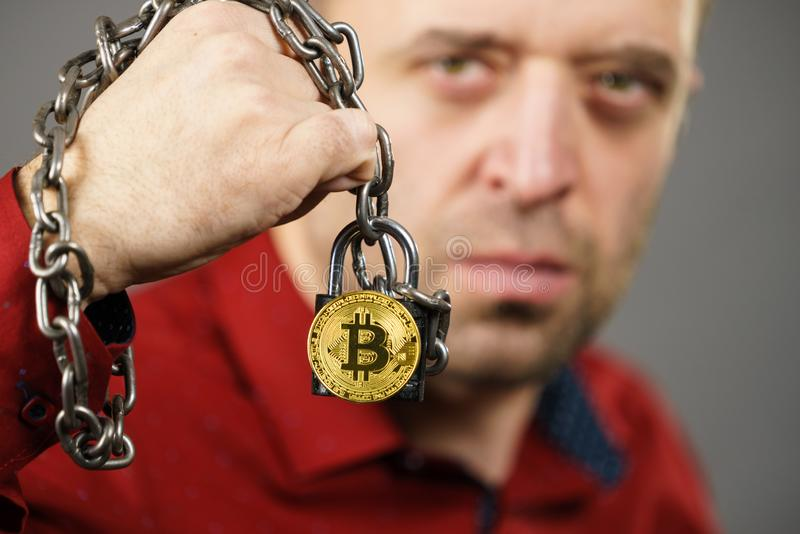 Man being tied up in block chain. Man having problems with crypto currency. Adult guy being tied up with block chain bitcoin royalty free stock photos
