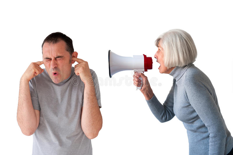 Man being yelled at by senior woman. Man being yelled at by senior women on white royalty free stock photos