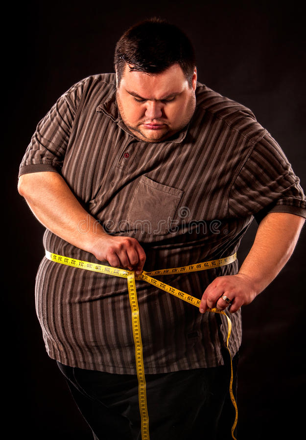 Man belly fat with tape measure weight loss around body . royalty free stock photography