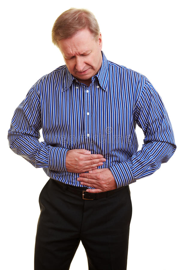 Man with bellyache. Elderly man holding his hands over his aching stomach royalty free stock image