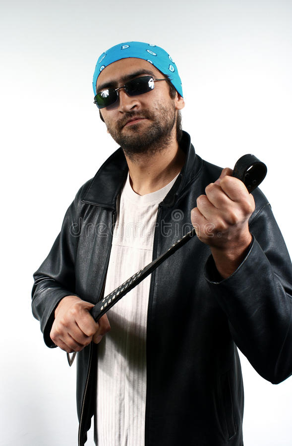 Download Man With A Belt In Dark Glasses Stock Photo - Image: 11216650