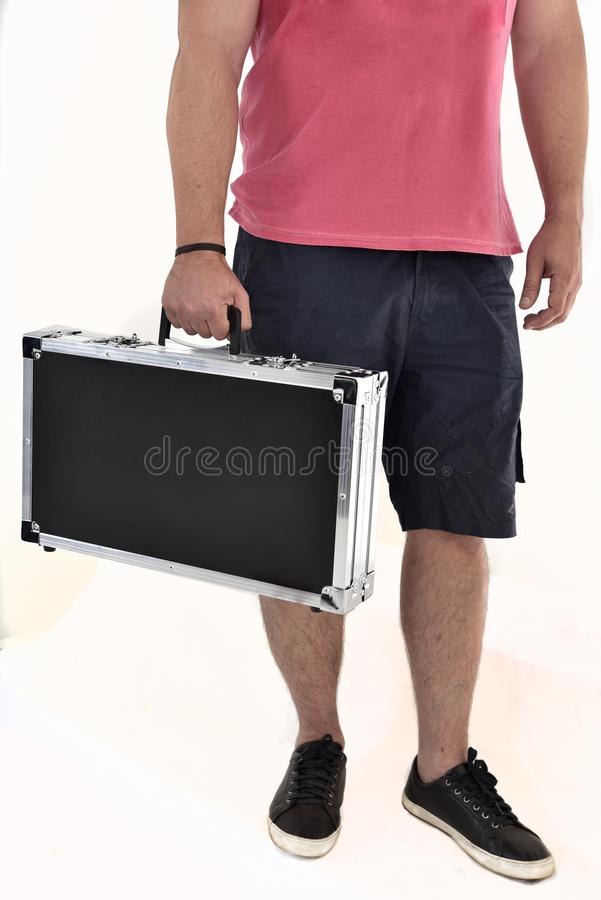 Man in bermuda carrying black briefcase on white background royalty free stock photo