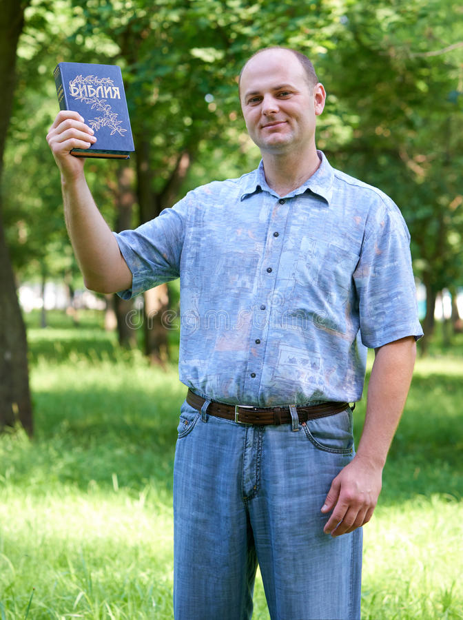 Man with a Bible in his hand stock photography