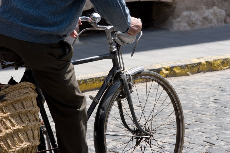 Man with bicycle stock image