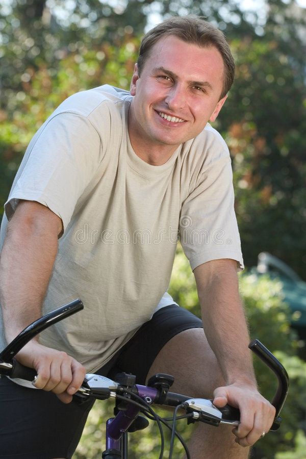 Man and bicycle stock images