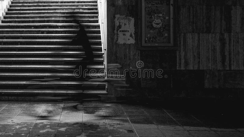 Man on a bicycle in the underground passing stock photo
