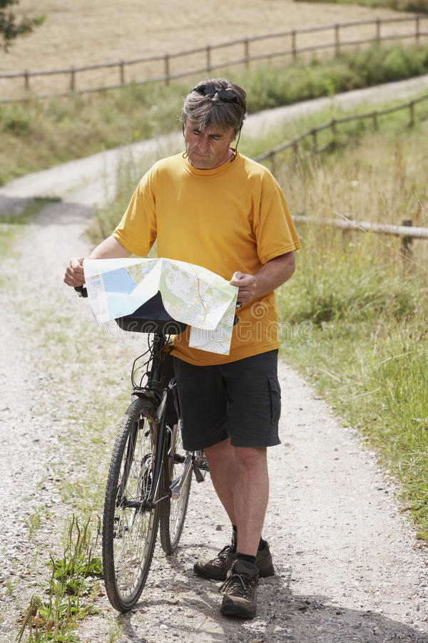 Download Man with bike stock image. Image of land, meadow, holding - 16094333