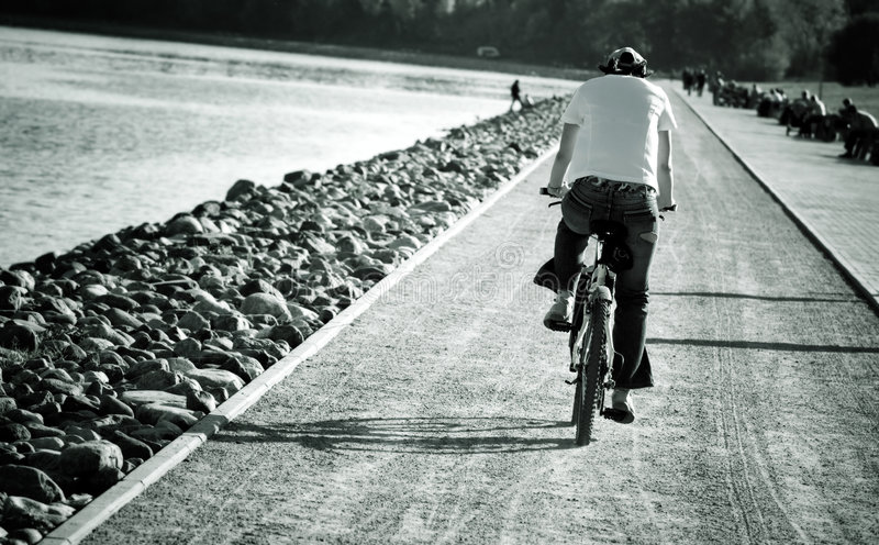 Man on bike. High contrast tinted image stock photography
