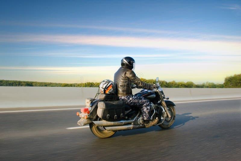 Man on bike royalty free stock photography