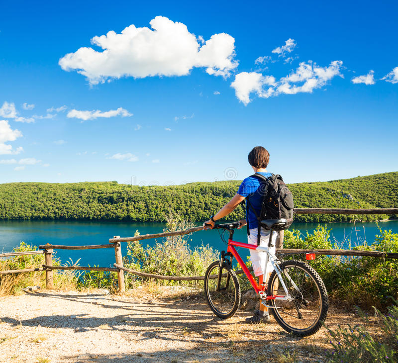 Beautiful Nature View: Man With A Bike On Beautiful Nature Background Stock Image