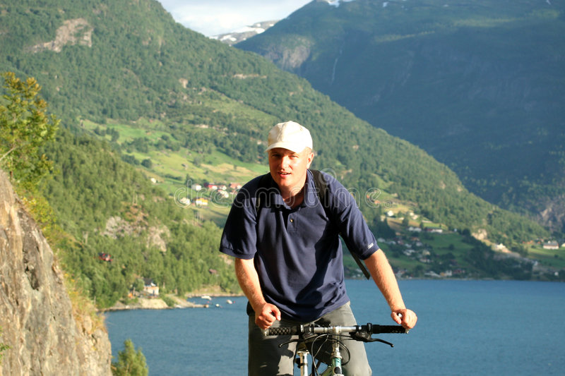 Man on bike in the mountains royalty free stock images