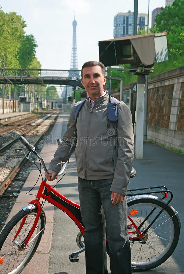 Man with bike in Paris royalty free stock photos
