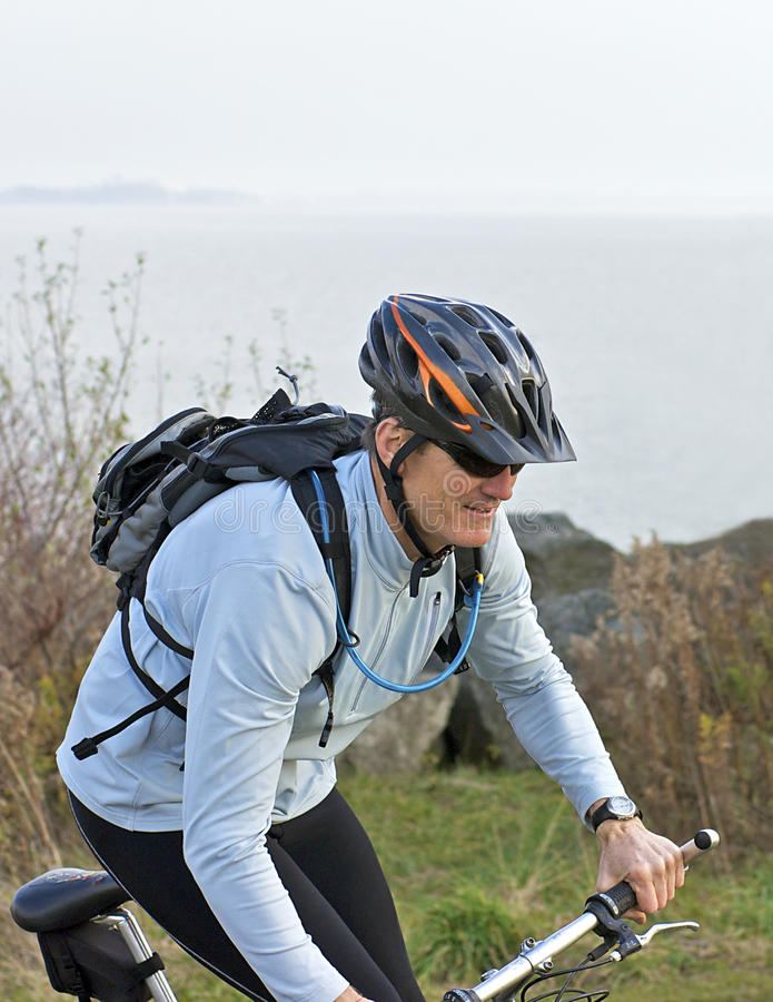Download Man on bike by the Water stock image. Image of landscape - 11884291