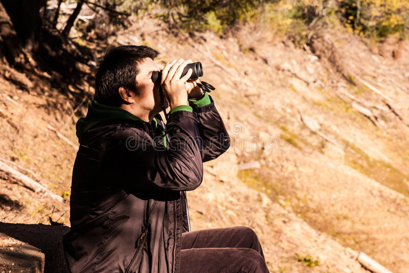Man with binoculars royalty free stock image