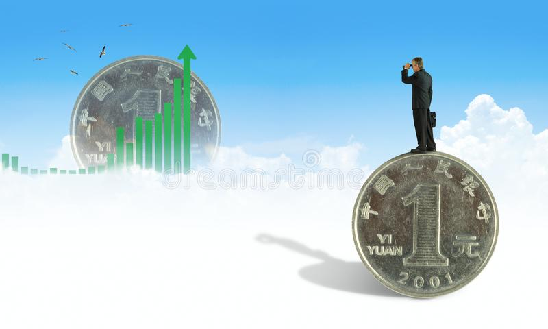 Man with binoculars standing on giant yuan looking at upward graph seeking financial success in Chinese markets stock photo