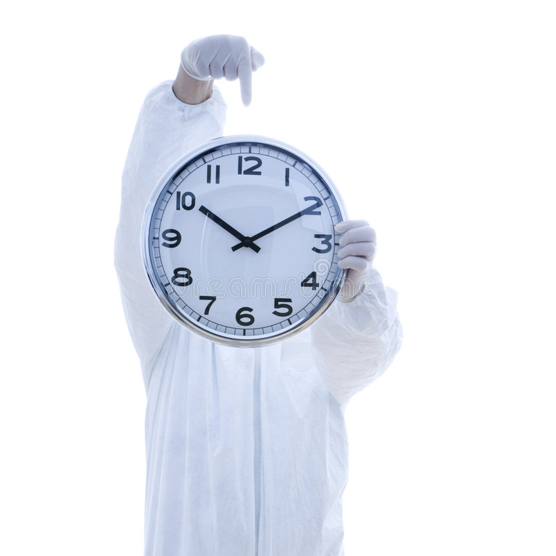 Man In Biohazard Suit Holding Clock. Royalty Free Stock Photos