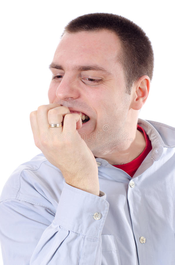 Man biting nails nervously stock photography