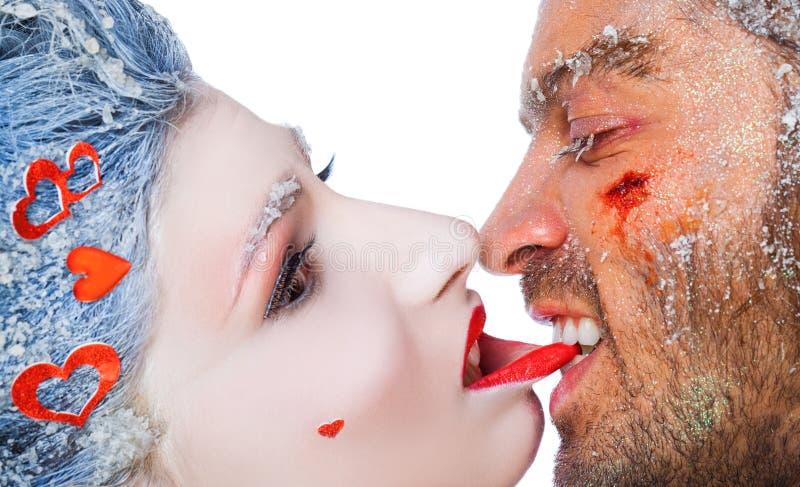 Man biting woman's lip make-up royalty free stock images