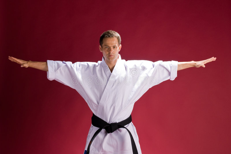 Man with black belt. A young man with a black belt in karate royalty free stock image