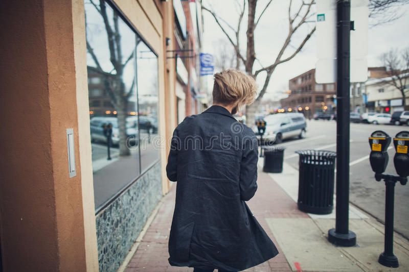 Man In Black Coat Standing Near Building And Street At Daytime Free Public Domain Cc0 Image