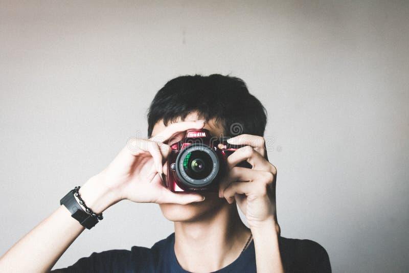 Man in Black Crew-neck Shirt Using Red Bridge Camera royalty free stock photos