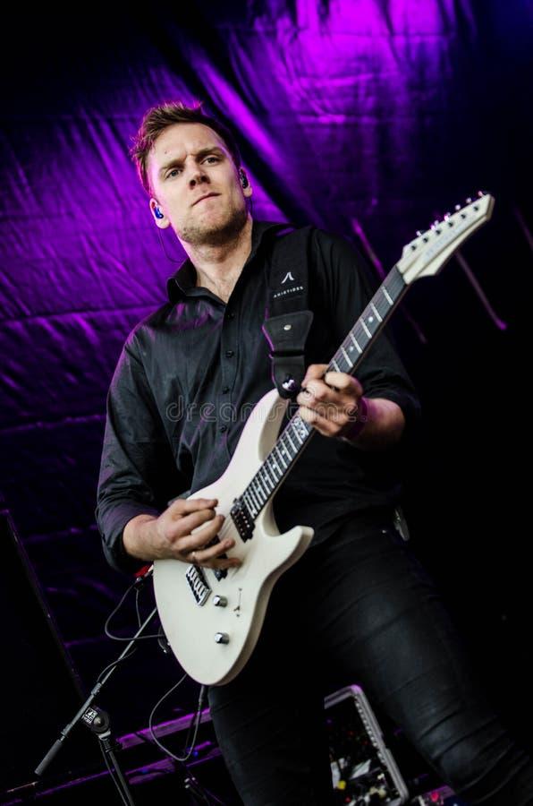 Man in Black Dress Shirt Playing Guitar royalty free stock image
