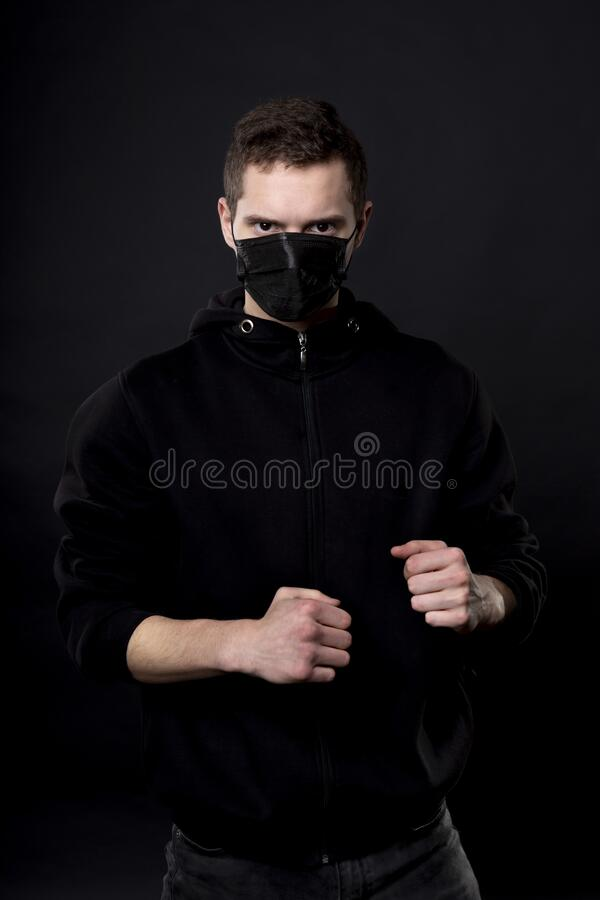 Black Man With Clenched Fists Stock Photo