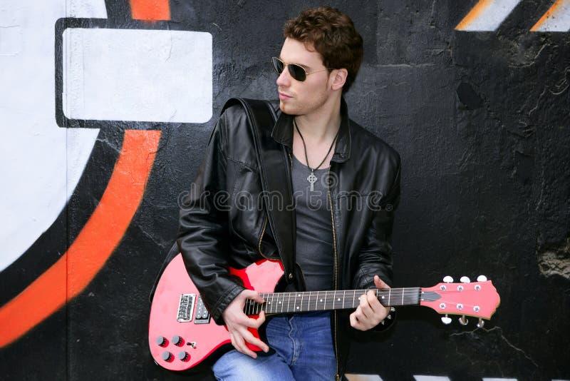 Man black graffiti holding electric guitar royalty free stock images