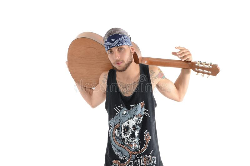 Man in Black and Grey Tank Top Carrying Brown Classical Guitar royalty free stock image