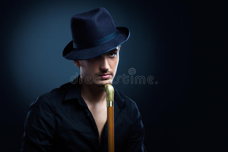 Man in a black hat stock photography