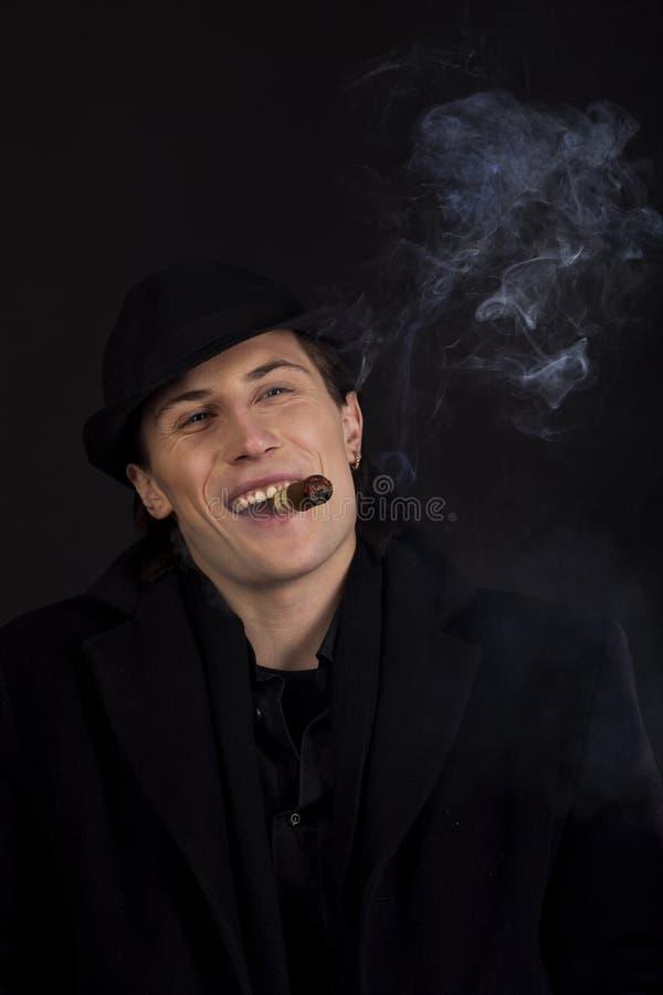 Download Man In Black Hat Smoke Cigar And Smile Royalty Free Stock Images - Image: 12570419
