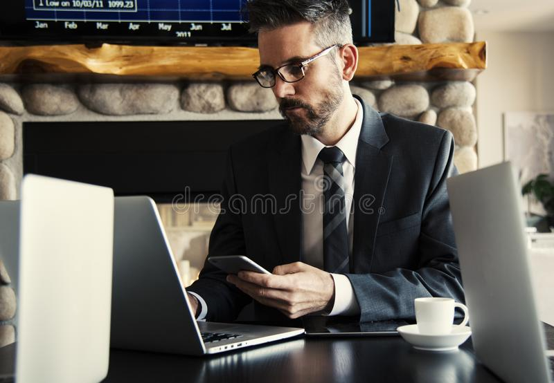 Man in Black Holding Phone royalty free stock image